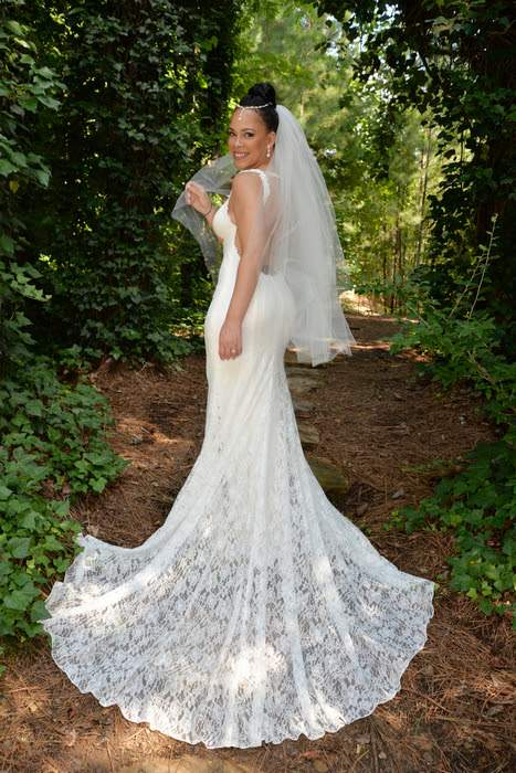 outdoor photo of bride in ivy walkway at gala