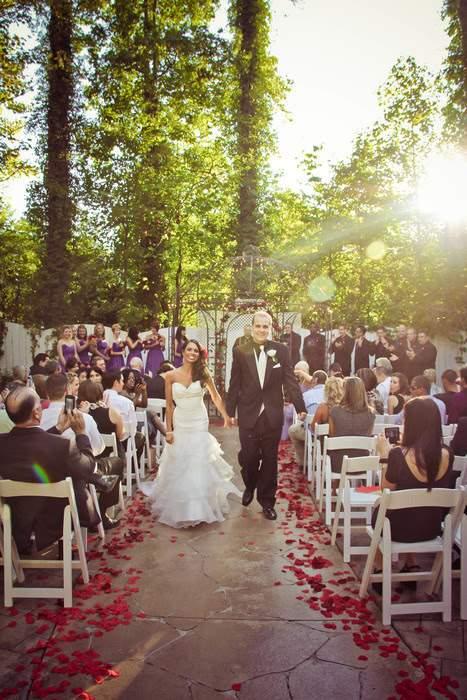 bride and groom walking down aisle at outdoor wedding in Marietta, GA
