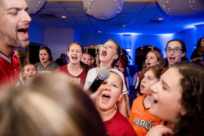 group of kids singing into microphone at special events venue party in Marietta, GA