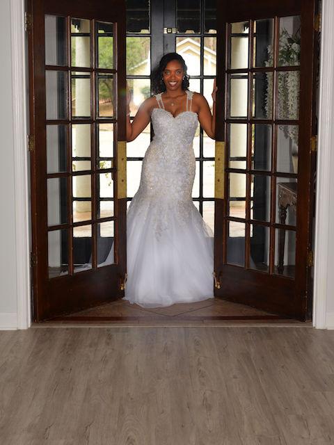bride walking through french doors at wedding venue